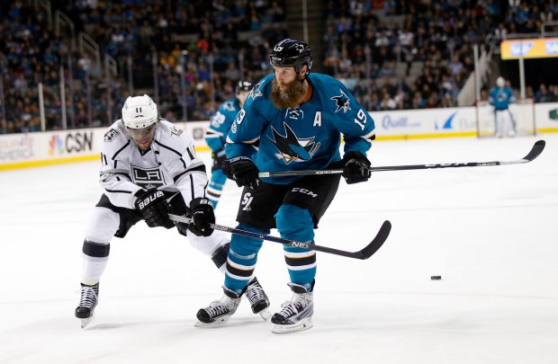 Los Angeles Kings' Anze Kopitar (11) battles for the puck against the San Jose Sharks' Joe Thornton (19) in the first period of their NHL game at SAP Center in San Jose, Calif., on Tuesday, January 3, 2017. (Josie Lepe/Bay Area News Group)