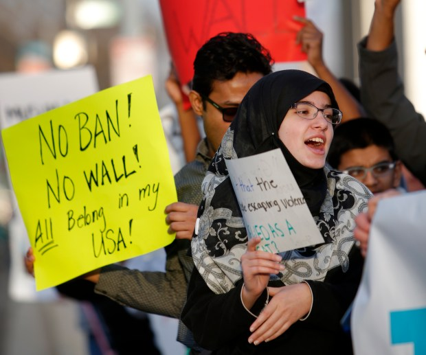 Nada Sarhan,14, participates in a protest at San Jose City Hall on Sunday, Jan. 29, 2017, in San Jose, Calif. Nearly 200 protesters were upset with President Donald Trump's executive order banning citizens from seven Muslim-majority countries from entering the country. (Josie Lepe/Bay Area News Group)