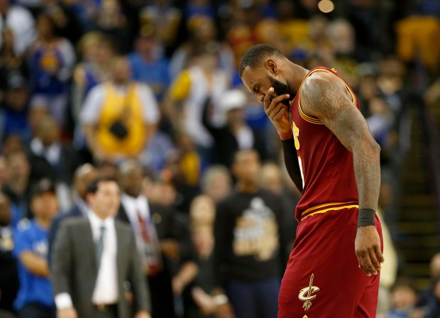 Cleveland Cavaliers LeBron James (23) walks off the court after a flagrant foul by Golden State Warriors Draymond Green (23) in the second quarter of their game at Oracle Arena in Oakland, Calif., on Monday, Jan. 16, 2017. (Jane Tyska/Bay Area News Group)