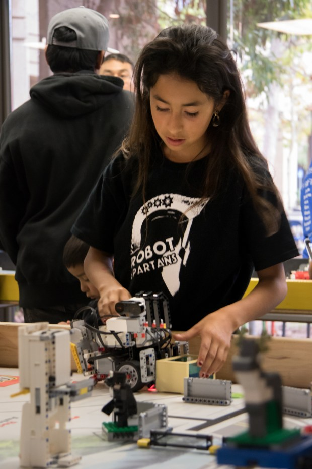 Cristina, 12, a member of the Robot Spartans, works with a Lego robot during a First Lego League qualifying round in November at the Google campus in Mountain View. The Spartans, sponsored by Bayshore Christian Ministries in East Palo Alto, moved on to regionals. (Courtesy of Bayshore Christian Ministries)