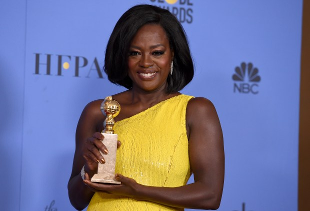"""Viola Davis poses in the press room with the award for best performance by an actress in a supporting role in any motion picture for """"Fences"""" at the 74th annual Golden Globe Awards at the Beverly Hilton Hotel on Sunday, Jan. 8, 2017, in Beverly Hills, Calif. (Photo by Jordan Strauss/Invision/AP)"""