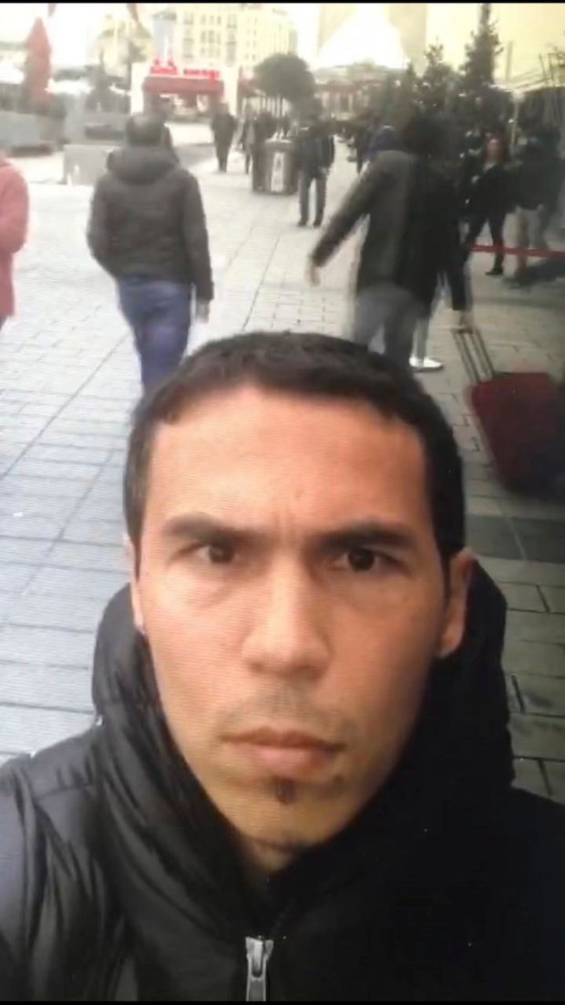 A man believed to be the gunman who killed dozens at an Istanbul nightclub takes video of himself  as he wanders nearby Istanbul's crowded Taksim square.   (DHA-Depo Photos via AP)