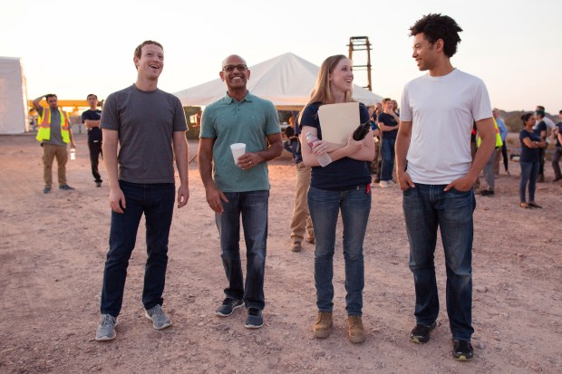 Mark Zuckerberg, Facebook CEO and co-founder; Jay Parikh, global head of engineering and infrastructure; Kathryn Cook, technical program manager for Aquila and Yael Maguire, head of Connectivity Lab stand at the Aquila test site in Arizona. (Provided by Facebook)