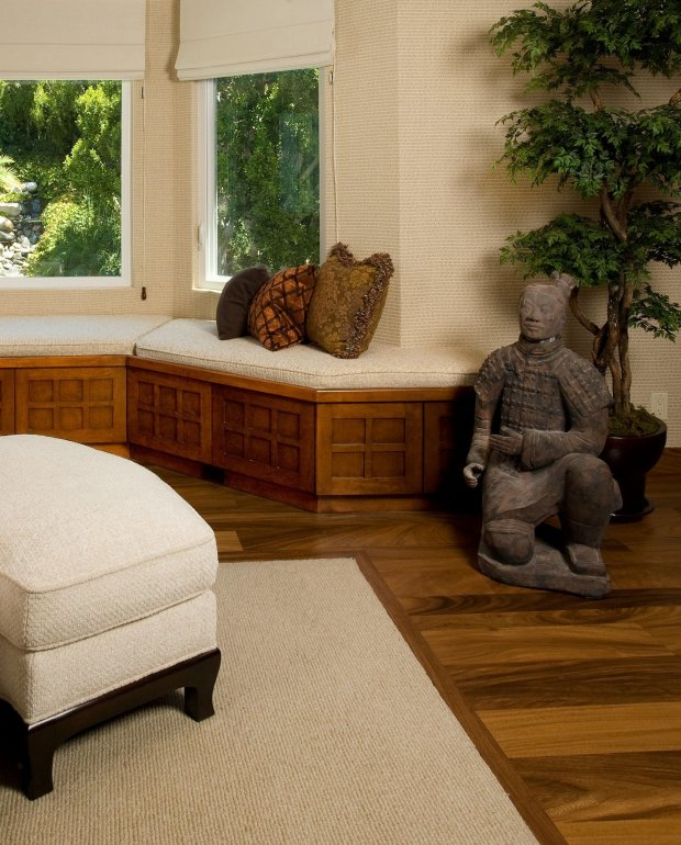 """You don't have to put """"Winged Victory"""" in your home, or a bust byGiacometti. Sculpture is any art that is three-dimensional, that is interesting to look at, that cuts through space and that you can enjoy from different angles. Here, a Chinese warrior sculpture in a living room setting. (Photo courtesy of Arch-Interiors Design Group)"""
