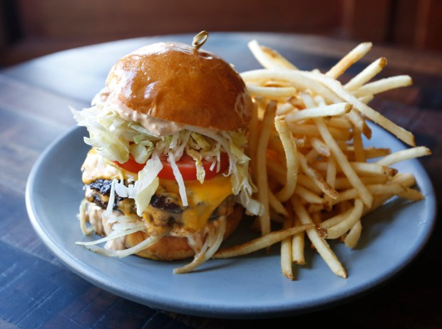 A burger is one of the offerings at Finn Town in San Francisco, Calif., Thursday, Feb. 23, 2017. Finn Town is the new Castro restaurant from Top Chef alum Ryan Scott. (Patrick Tehan/Bay Area News Group)