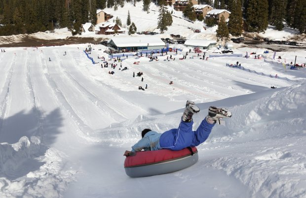 An intrepid tuber heads head-first down the chute at Leland Snowplay inLeland Meadows, near Pinecrest. (Photo courtesy of Dino Vournas)