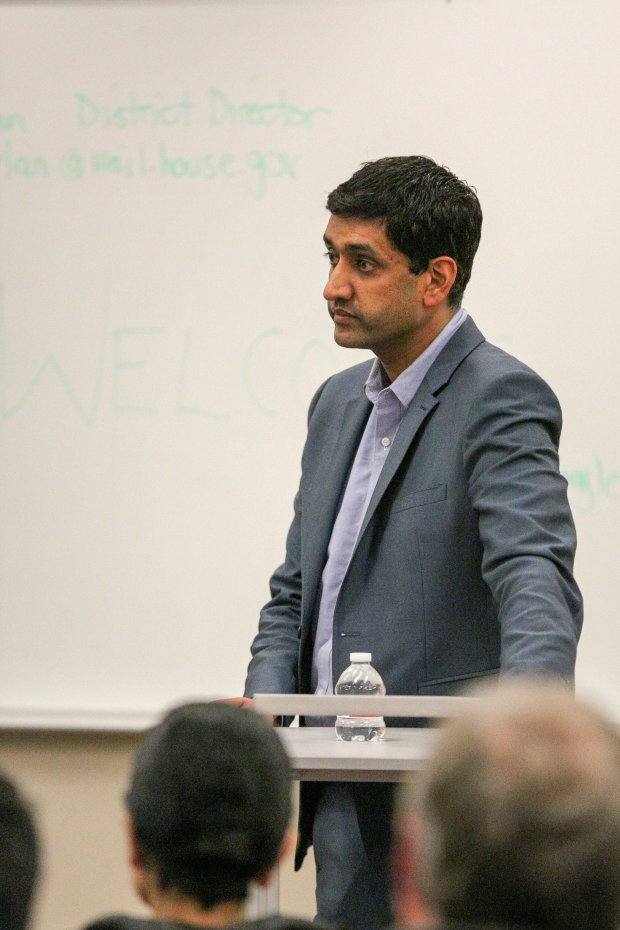 U.S. Rep. Ro Khanna listens to an audience member's question in a tightlypacked overflow room at Ohlone College in Fremont on Wednesday night during his first town hall as an elected official. Photo by Joseph Geha.