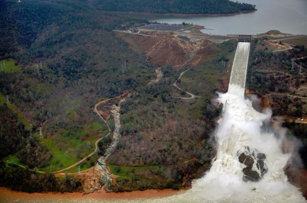 Water rages down the broken main spillway at Oroville Dam on Wednesday Feb. 15, 2017. (Dale Kolke / California Department of Water Resources)