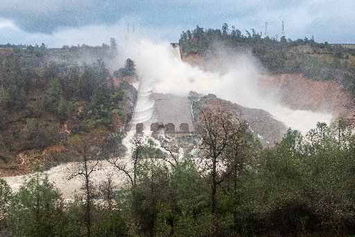 Water roars down the damaged main Oroville Dam spillway Wednesday. Continuing releases of 60,000 cubic-feet per second are exceeding the inflow into Lake Oroville, and the water level is dropping after the current wave of storms have passed. (Florence Low / California Department of Water Resources)