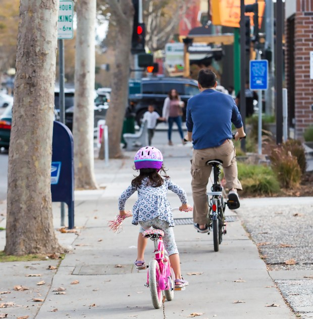 On some streets in San Jose -- including Lincoln Avenue, shown here -- children 12 and under, and adults accompanying them, can ride bicycles on sidewalks. (Jacqueline Ramseyer/Bay Area News Group/Nov. 6, 2016)