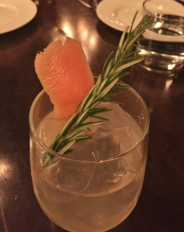 The Gin & Tonic at the Oxford, made with Bombay Sapphire and a specialtonic water blend produced by the distillery, is garnished with a grapefruit peel and a sprig of rosemary. (Sal Pizarro/Staff)