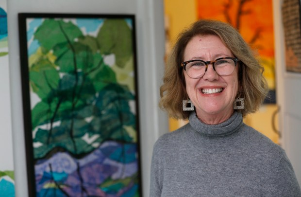 """Freelance artist Robin Schreiber is photographed at her studio in Belmont, Calif., on Tuesday, Feb. 7, 2017. Schreiber, an Oakland native, became known as the Golden State Warriors """"Dance Mom"""" after a video of her dancing in an ugly sweater at a November Warriors' game went viral, leading to an opportunity to dance on the court with the Warriors Dance Team in December. (Jane Tyska/Bay Area News Group)"""
