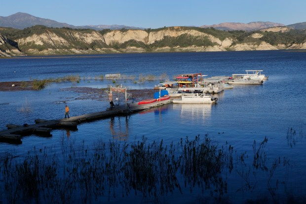 Gabriel De la Cruz, of Hesperia, finishes a day of work moving boat docks as the water slowly rises at Cachuma Lake Thursday, Feb. 23, 2017, in Santa Barbara County, Calif. Despite all the rain this winter, the reservoir is only at 40 percent capacity. (Jim Gensheimer/Bay Area News Group)