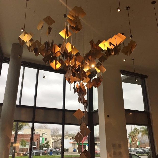 """Growth,"" an anodized aluminum mobile by New York-based artist Brian Brush,is one of the pieces installed in the art-filled lobby of the Pierce, a new apartment building in San Jose's SoFA District. (Sal Pizarro/Staff)"