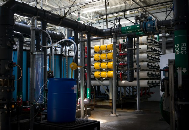 Inside Sand City's desalination plant, the blue housings hold filters that remove particles before the raw water gets into the reverse osmosis system. The yellow cylinders are devices that lower energy costs.