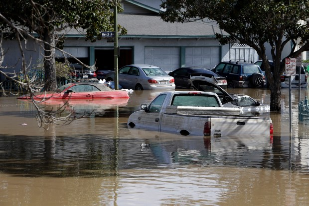 Nordale Ave. in the Rock Springs neighborhood remains flooded after the previous day's storm in San Jose, Calif. on Wednesday, Feb. 22, 2017. (LiPo Ching/Bay Area News Group)