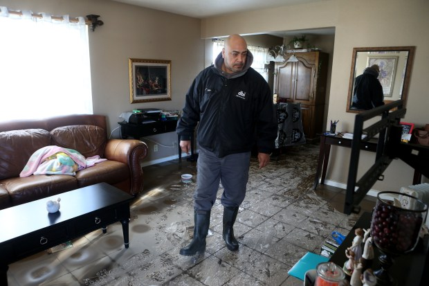 Resident Luis Rascon surveys the damage to his home after flooding along Rock Springs Drive in San Jose, Calif., on Thursday, Feb. 23, 2017. Rascon who has lived in the neighborhood for 25 years with his family and owns and operates the multi-unit building he lives in plans to stay and repair the damage. (Anda Chu/Bay Area News Group)
