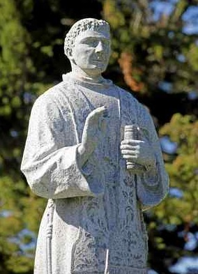 The head of the St. Junipero Serra statue at the Lower Presidio Historic Park in Monterey is reattached after 16 months on Monday. (Vern Fisher - Monterey Herald)