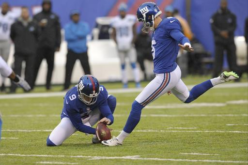New York Giants Robbie Gould (5) kicks a field goal as Brad Wing (9) holds during the first half of an NFL football game against the Detroit Lions Sunday, Dec. 18, 2016, in East Rutherford, N.J. (AP Photo/Bill Kostroun)