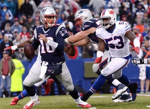 New England Patriots quarterback Jimmy Garoppolo (10) scrambles out of the pocket pursued by Buffalo Bills linebacker Zach Brown (53) during the second half of an NFL football game Sunday, Oct. 30, 2016, in Orchard Park, N.Y. The Patriots win 41-25. (AP Photo/Adrian Kraus)