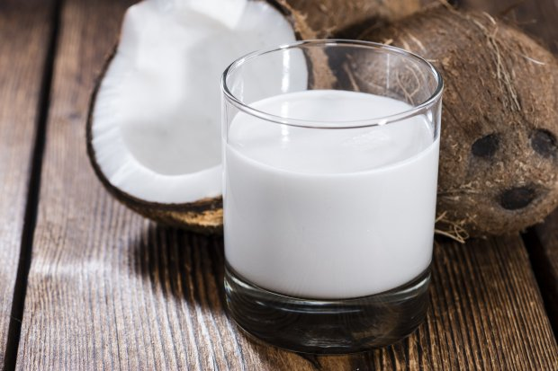 "Coconut milk is made by grinding the meat of mature coconuts with water,then squeezing the pulp to produce a rich ""milk."" (Courtesy Handmade Pictures)"