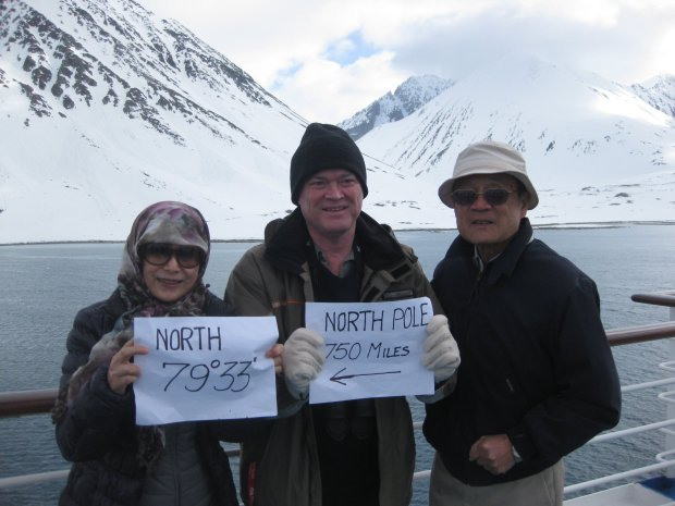 *NORWAY:* A Norwegian coastal cruise took Walnut Creek residents Peri andCK Chen -- pictured here with a fellow passenger in the middle -- to the Magdalene fjord within the Arctic Circle. (Courtesy Chen Family)
