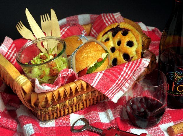Heading to a winery for a little tasting? Pack a delicious picnic lunch to enjoy among the vines with this menu of herb-roasted turkey and brie sandwiches, smoky bacon-apple slaw and a polka-dotted blueberry-cherry pie. (Mark DuFrene/Bay Area News Group)