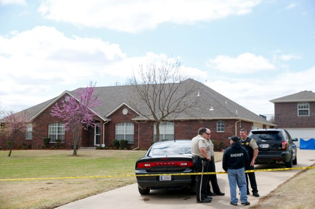 The scene of a failed robbery that led to the death of three men who broke into the house in Broken Arrow, Okla., Monday, March 27, 2017. (Ian Maule/Tulsa World via AP)