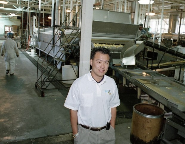 Keith Kim is pictured at the Granny Goose factory in Oakland, July 26, 1995. Kim purchased the struggling potato chip factory in 1995. (Ron Riesterer / Courtesy of Hayward Area Historical Society, Oakland Tribune Collection)