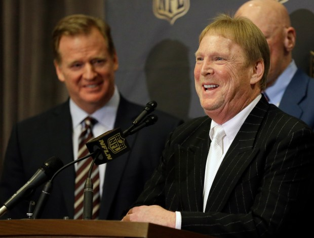 FILE - In this Jan. 12, 2016, file photo, NFL Commissioner Roger Goodell, left, laughs as Oakland Raiders owner Mark Davis talks to the media after an NFL owners meeting in Houston. The Raiders have filed paperwork to move to Las Vegas. Clark County Commission Chairman Steve Sisolak told The Associated Press on Thursday, Jan. 19, 2017, that he spoke with the Raiders. (AP Photo/Pat Sullivan, File)