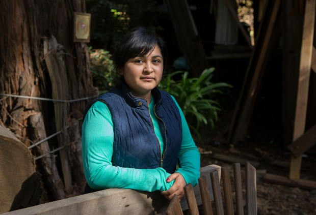 Deetjen's Big Sur Inn employee Viancy Cortez, 24, poses for a portrait at Deetjen's Big Sur Inn in Big Sur, Calif. on Wednesday, March, 8, 2017. Cortez has been stuck on the south side of the bridge and isolated from family and friends in the north. (LiPo Ching/Bay Area News Group)