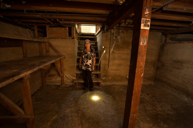 Joan Rivas-Cosby looks over the damage in the basement of her home in San Jose, Calif., Thursday, Mar. 16, 2017. In the wake of a devastating flood that ripped apart her basement, Joan Rivas-Cosby gave $2,500 to a man who promised to have it looking like new in a few hours. But the man, who's done this to at least two other San Jose flood victims, disappeared -- and now Rivas-Cosby is left footing the bill. (Patrick Tehan/Bay Area News Group)