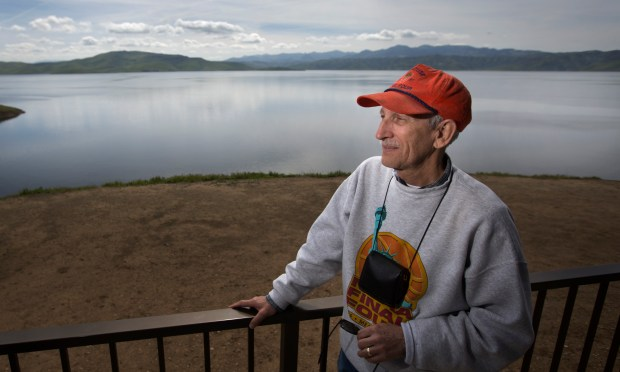 Former guide Howard Berman, of Los Banos, takes in the view at San Luis Reservoir near Los Banos, Calif., Tuesday, Mar. 7, 2017. Six months ago, San Luis Reservoir, the vast lake along Highway 152 between Gilroy and Los Banos, and a key source of drinking water for Silicon Valley, was just 10 percent full, the lowest level in 27 years. But now, in a stunning turnaround, San Luis Reservoir is full. (Patrick Tehan/Bay Area News Group)