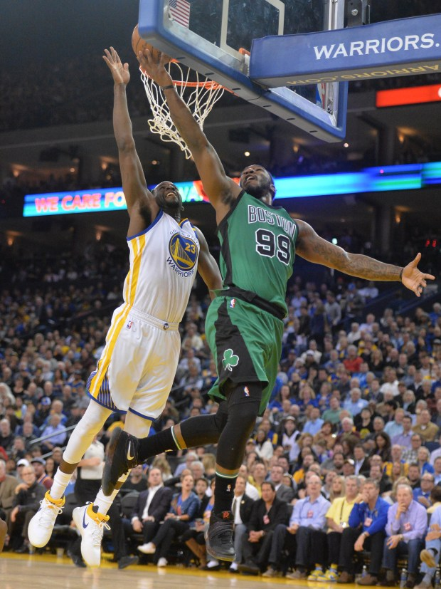 Golden State Warriors' Draymond Green (23) blocks a shot by Boston Celtics' Jae Crowder (99) in the first half of their basketball game at Oracle Arena in Oakland, Calif., on Wednesday, March 8, 2017. (Doug Duran/Bay Area News Group)