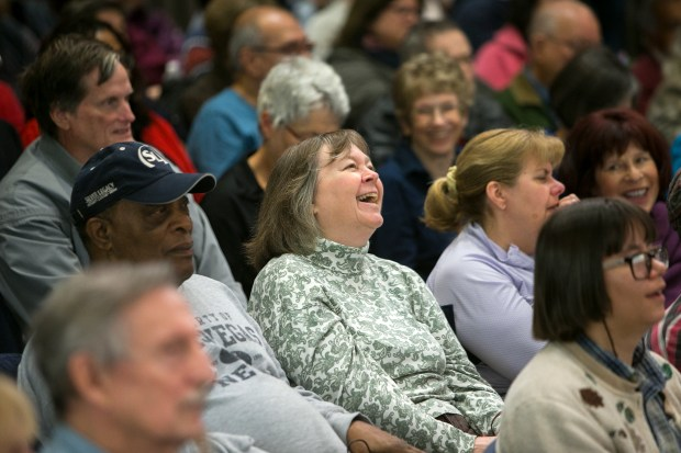 Kerry Moore, 55, of San Jose, center, reacts during Rep. Zoe Lofgren's (D-San Jose) talk at a Town Hall meeting in the Board of Supervisors Chambers in the County Government Center in San Jose, Calif., on Sat., March 25, 2017. (LiPo Ching/Bay Area News Group)