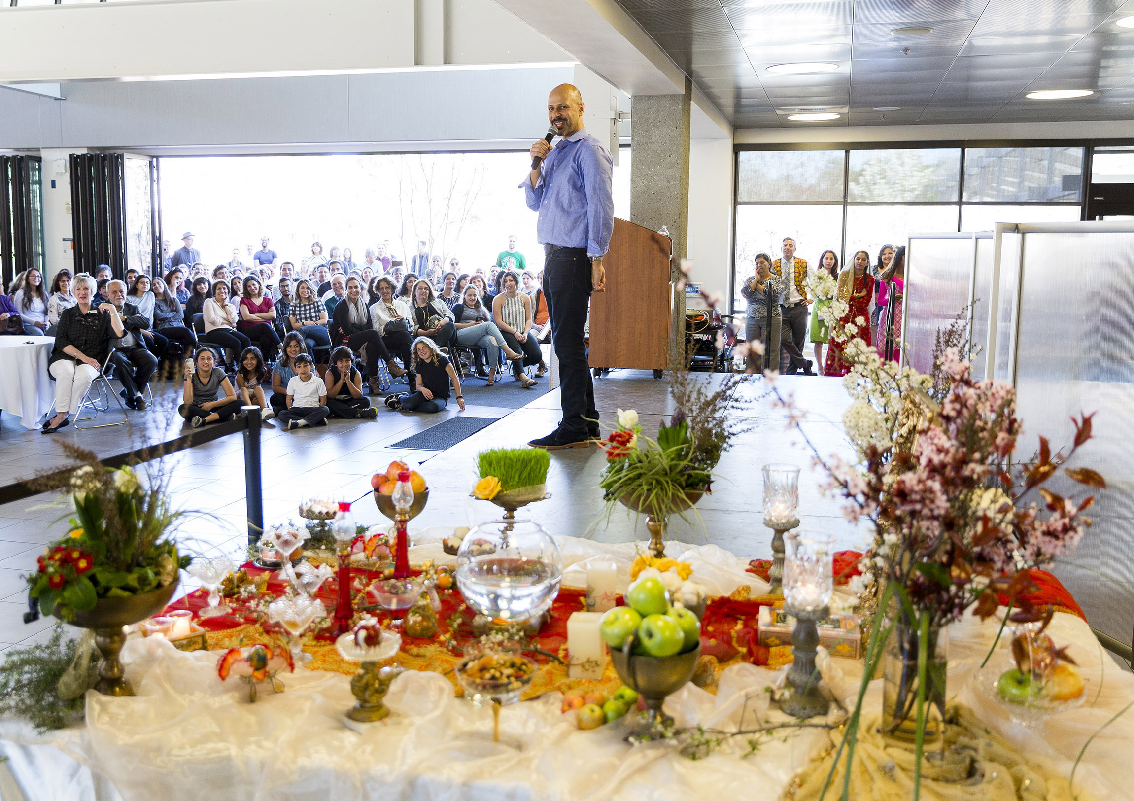 Photograph courtesy of Nick Gonzales/West Valley College  Comedian and actor Maz Jobrani performs at West Valley College's Persian New Year celebration on March 13.