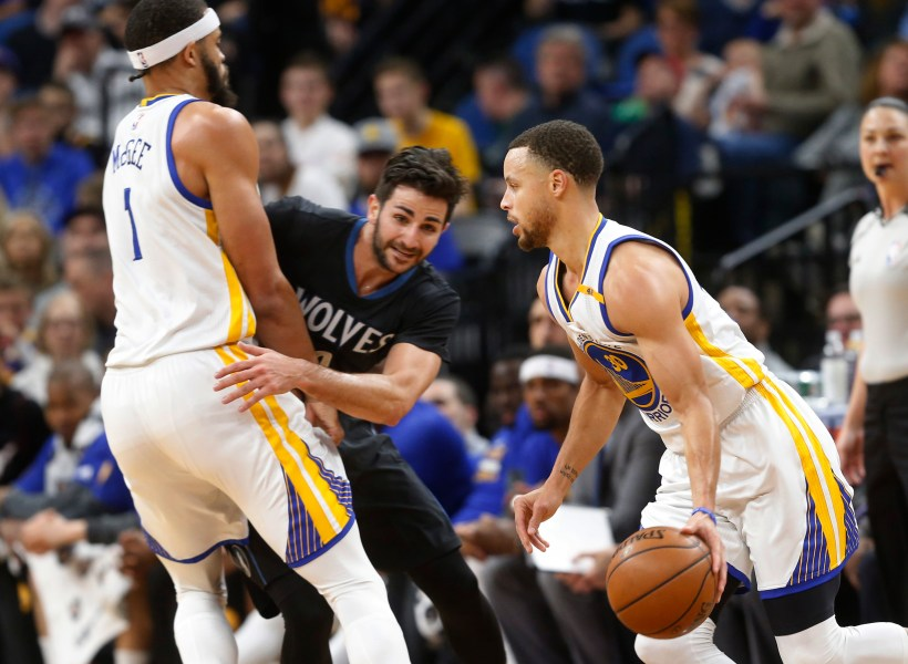 Warriors conduct odd postgame interviews after loss to Wolves Golden State Warriors  JaVale McGee  left  sets a pick on Minnesota  Timberwolves  Ricky Rubio of Spain as Stephen Curry  right  drives by  during the first