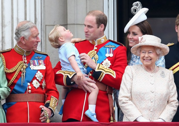 LONDON, ENGLAND - JUNE 13: Prince George of Cambridge is held by Prince William, Duke of Cambridge and Catherine, Duchess of Cambridge, Prince Charles, Prince of Wales and Queen Elizabeth II look out on the balcony of uckingham Palace during the Trooping the Colour on June 13, 2015 in London, England. . The ceremony is Queen Elizabeth II's annual birthday parade and dates back to the time of Charles II in the 17th Century when the Colours of a regiment were used as a rallying point in battle. (Photo by Chris Jackson/Getty Images)
