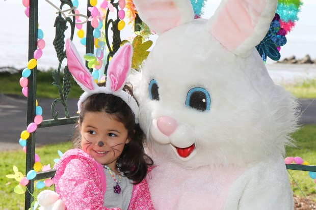 Estelle Braude, 4, of Alameda, gets her picture taken with the Easter Bunny before the egg hunting during the 2017 Splash Into Spring Egg Scramble held at the Crab Cove picnic area at the Robert W. Crown Memorial State Beach in Alameda, Calif., on Saturday, April 15, 2017. The annual event included several activities for kids and was hosted by the East Bay Regional Park District, the Rotary Club of Alameda, the Alameda Friends of the Parks Foundation and the Alameda Recreation and Park Department. (Ray Chavez/Bay Area News Group)