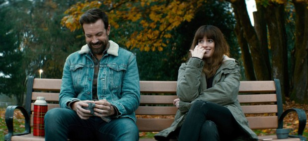 """Oscar (Jason Sudeikis), left, offers the down-and-out Gloria (Anne Hathaway) a job in his bar in """"Colossal."""" (Neon)"""