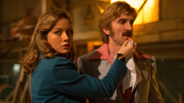 "This image released by A24 shows Brie Larson, left, and Sharlto Copley in a scene from ""Free Fire."" (Kerry Brown/A24 via AP)"