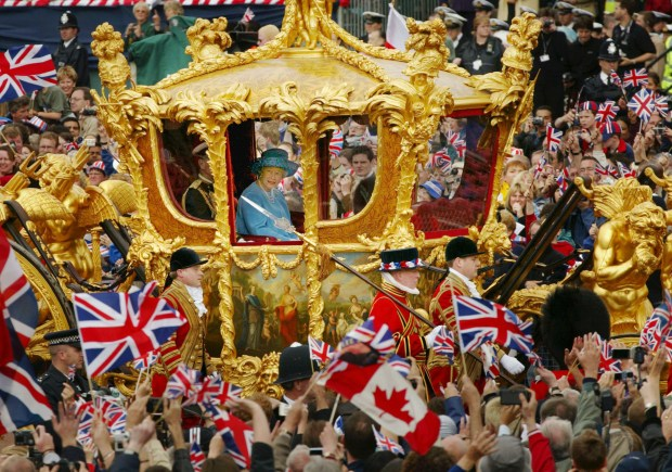406180 03: Britain's Queen Elizabeth (R) and Prince Philip ride in the Golden State Carriage at the head of a parade from Buckingham Palace to St Paul's Cathedral celebrating the Queen's Golden Jubilee June 4, 2002 along The Mall in London. (Photo by Sion Touhig/Getty Images)
