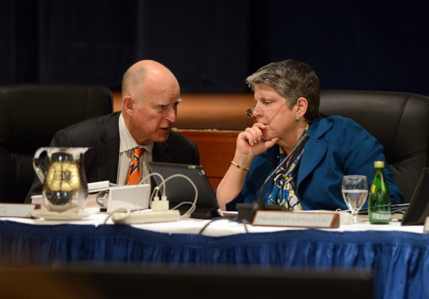 Gov. Jerry Brown and UC President Janet Napolitano chat during a UC board of regents meeting in San Francisco, Calif. on Wednesday, March 18, 2015. Brown and Napolitano have formed a Select Committee on the Cost Structure of the University and have since met twice to consider proposals to cut costs while improving quality. (Kristopher Skinner/Bay Area News Group)