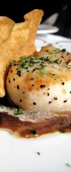 An appetizer of seared scallops at Chantilly. (Photo courtesy of Chantilly)