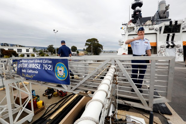Lt. Donnie Brzuska salutes as he exits the Coast Guard Cutter Stratton while docked at Coast Guard Island in Alameda, Calif., on Tuesday, April 11, 2017. (Laura A. Oda/Bay Area News Group)
