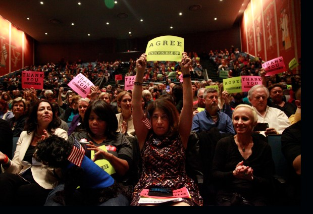 Francesca Wander holds up a sign expressing approval for a comment during a feisty town hall meeting held by Senator Dianne Feinstein at the Scottish Rite Masonic Center, Monday, April 17, 2017, in San Francisco, Calif. (Karl Mondon/Bay Area News Group)