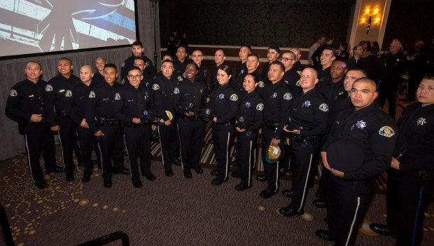 New officers pose for a group photo after the graduation ceremony for the San Jose Police Department's Academy 28 at the Fairmont Hotel in San Jose, Calif., April 28, 2017. The class has 27 graduates, the highest number since the academies were revived in 2013. (Patrick Tehan/Bay Area News Group)