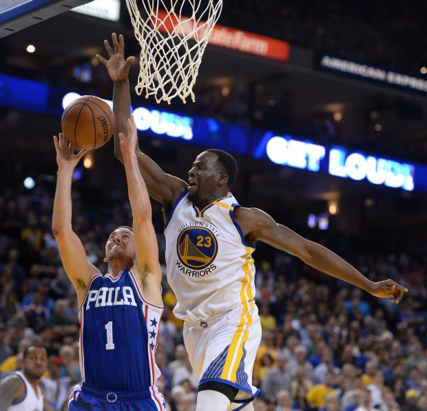 The Golden State Warriors' Draymond Green (23) blocks a shot by the Philadelphia 76ers' TJ McConnell (1) in the second half of their NBA game at Oracle Arena in Oakland, Calif., on Tuesday, March 14, 2017. (Dan Honda/Bay Area News Group Archives)