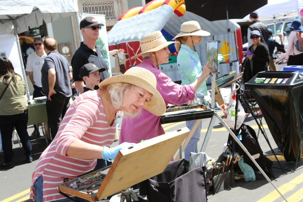 Photograph by George SakkestadMembers of the Los Gatos Art Association Plein Air Group, Marianne Woosley, left, Rebecca White and Nancy Takaichi paint landscapes during the Springs into Green event in downtown Los Gatos on April 23.