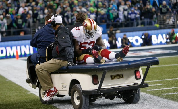 San Francisco 49ers' NaVorro Bowman (53) is carted off after being injured during the fourth quarter of the NFC Championship game against the Seattle Seahawks at CenturyLink Field in Seattle, Wash., on Sunday, Jan. 19, 2014. (Josie Lepe/Bay Area News Group)